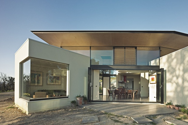 The house sits lightly in the landscape, with rooms arranged like a cluster of small buildings.