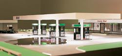 Gas, 2003, transforms Philip Johnson's Glass House into a service station. View of model installed at the MCA.