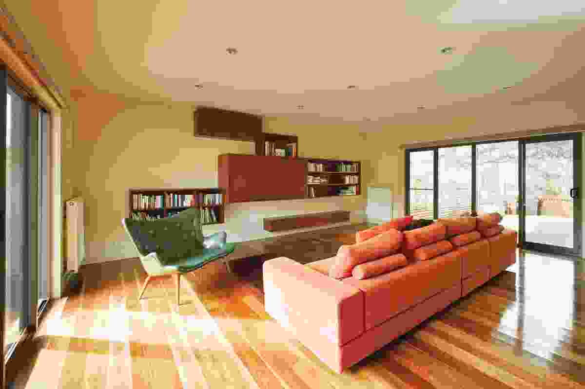 The living room features a custom-designed joinery unit.
