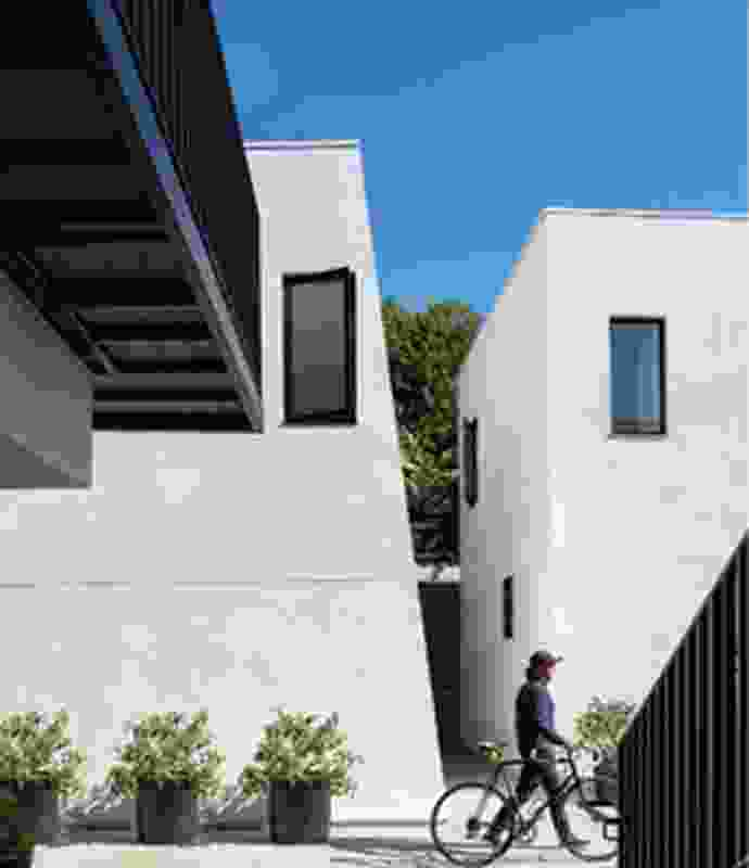 The ten-unit Ashland Apartments in Santa Monica, California (2019) appears as a collection of carved blocks. The design is inspired by Case Study House idylls of indoor–outdoor living.