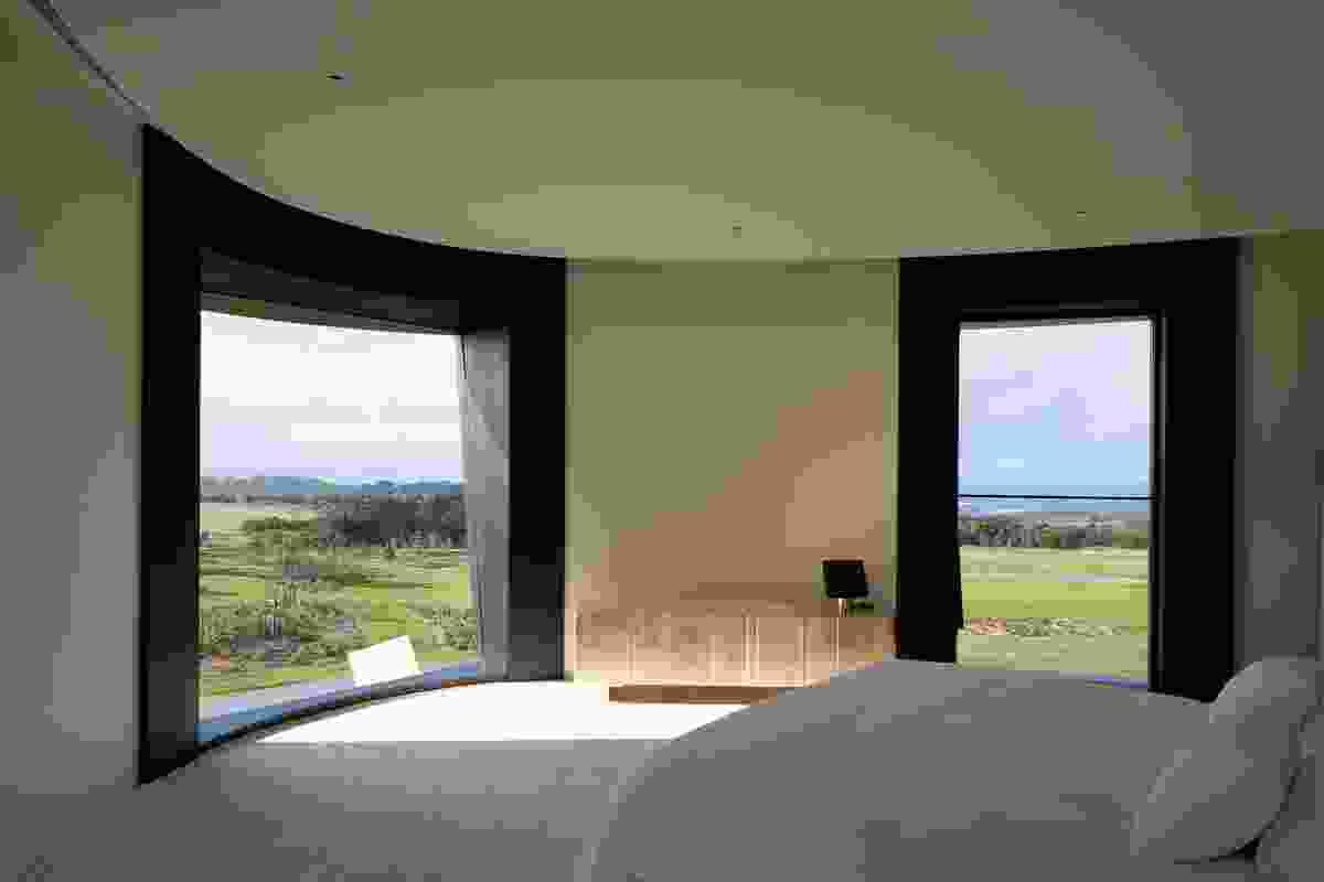 Deep window reveals frame the landscape.