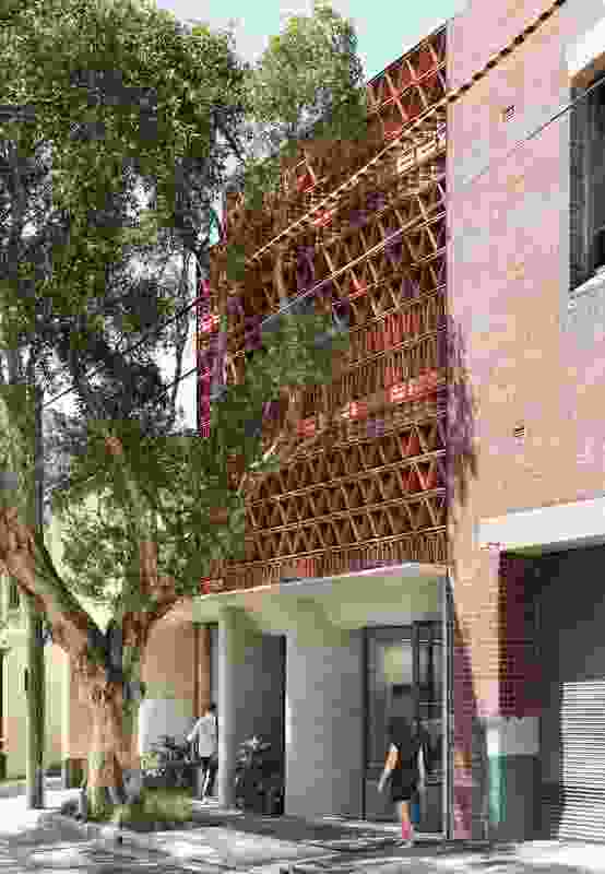 """Lead designer Raffaello Rosselli's interest in recycling materials """"from the start, rather than as an afterthought"""" finds expression in the building's distinctive shimmering facade. The tiles also function to mitigate the effects of the sun on the building's western elevation."""