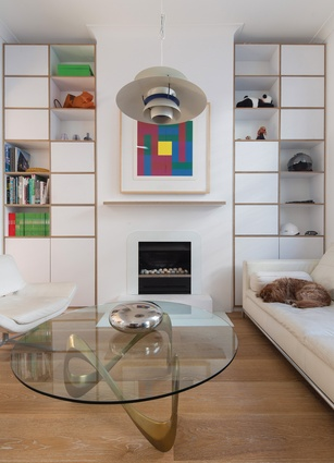 White surfaces and plywood edging are used throughout the home, creating a coherent design across the levels. Artwork: Richard Paul Lohse.
