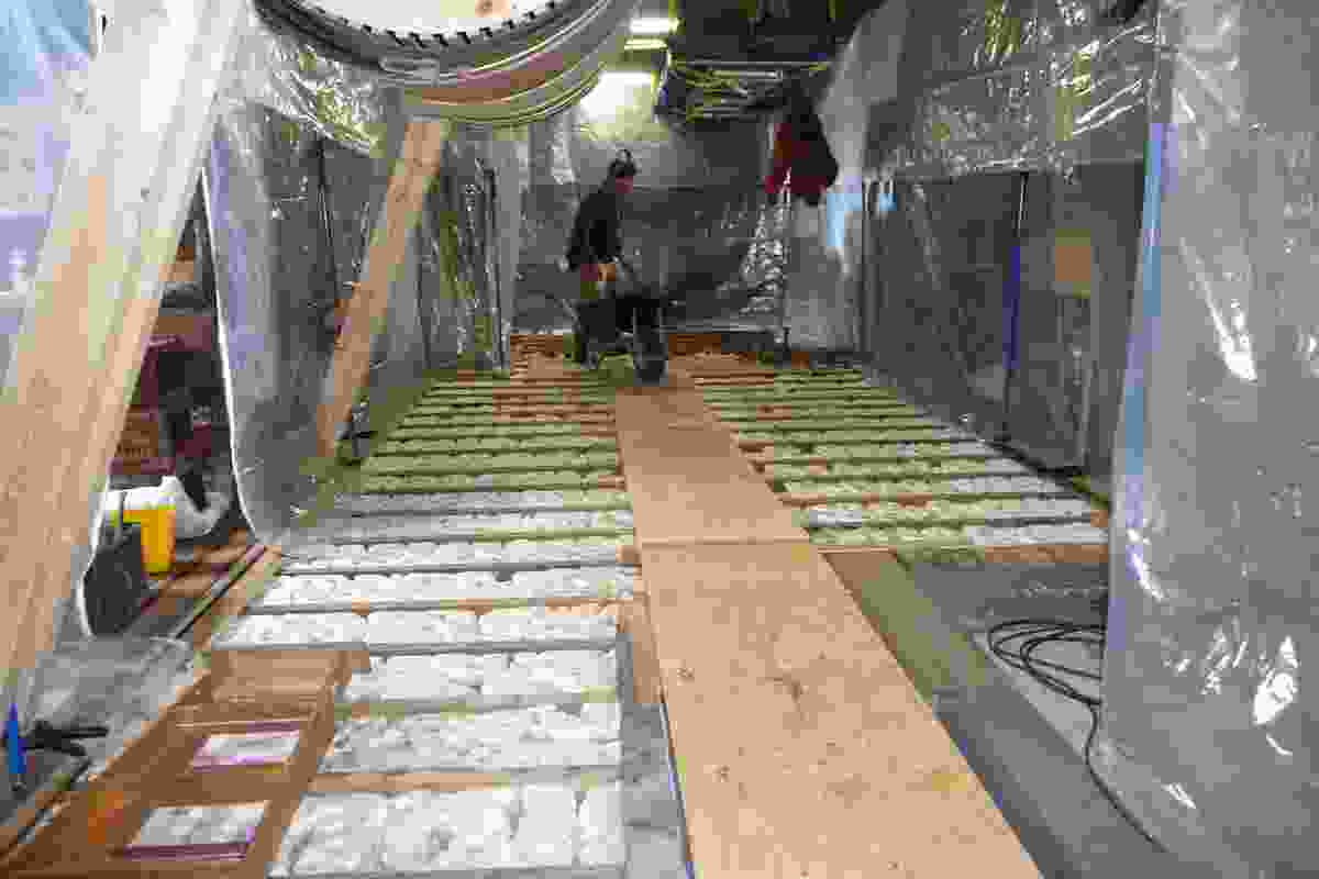 Restoration of the floor in Scott's Cape Evans Hut: The exposed floor shows ice build-up.