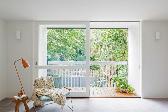 The main bedroom has a view of the treetops through a pop-out balcony.