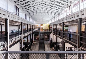 Studios are contained within the two-storey stables wing. First-floor studios on new floors are broken up with floor-to-roof voids that allow views of the original structure.