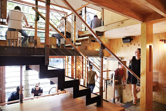Unlike most cafe interiors, Flipboard Cafe is vertically oriented with the help of a central staircase.
