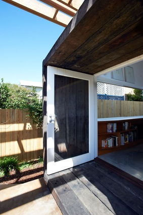 Timber sleepers frame French doors to the rear garden.