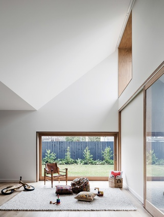 Under the dramatic folding ceiling, an almost child-sized sliding door offers external access to the rumpus, a space easily adaptable to the clients' changing needs.
