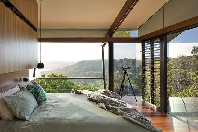 A grove of ghost gums is framed by the main bedroom; capturing the spectacular view was of prime importance in the home's design.