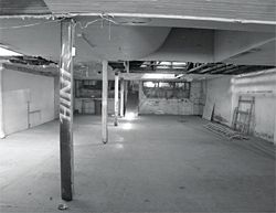 Interior views of condition of showroom prior to restoration.