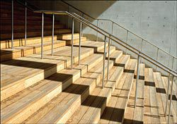 The wide timber entry stair, rising from Anzac Parade.