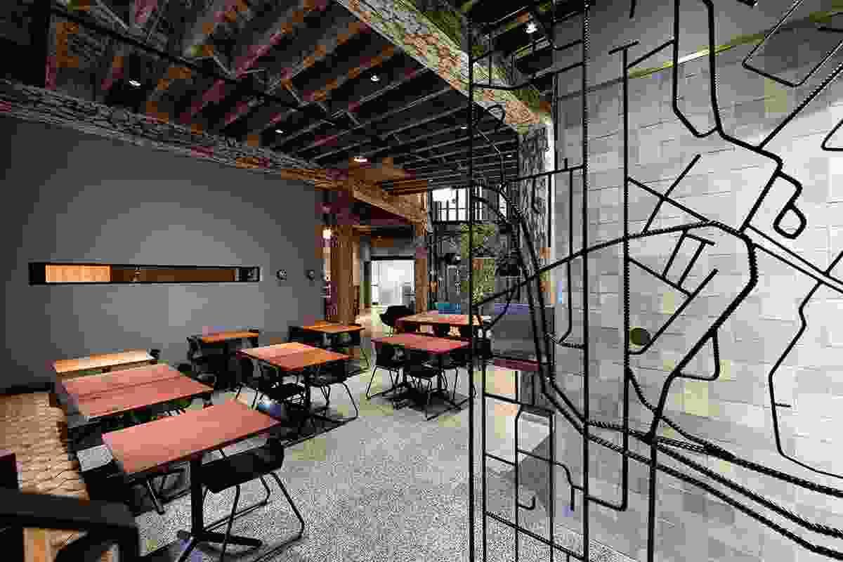 Industrial heritage expressed in steel screens in the restaurant.