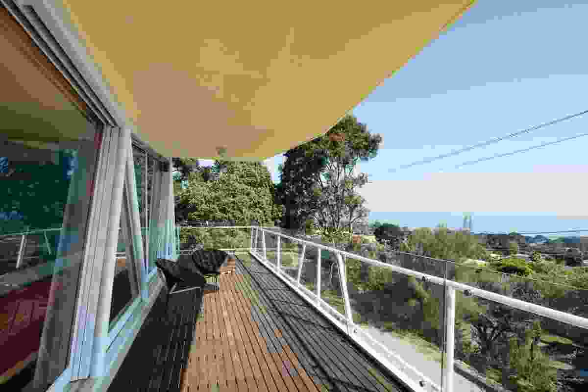 A shaded balcony extends out to views of Port Phillip Bay to the north.