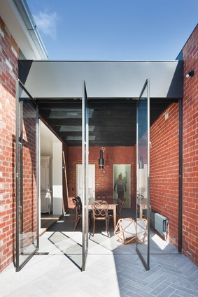 At St Kilda East House, the boundary between indoors and out is blurred by concrete pavers laid in a herringbone pattern.