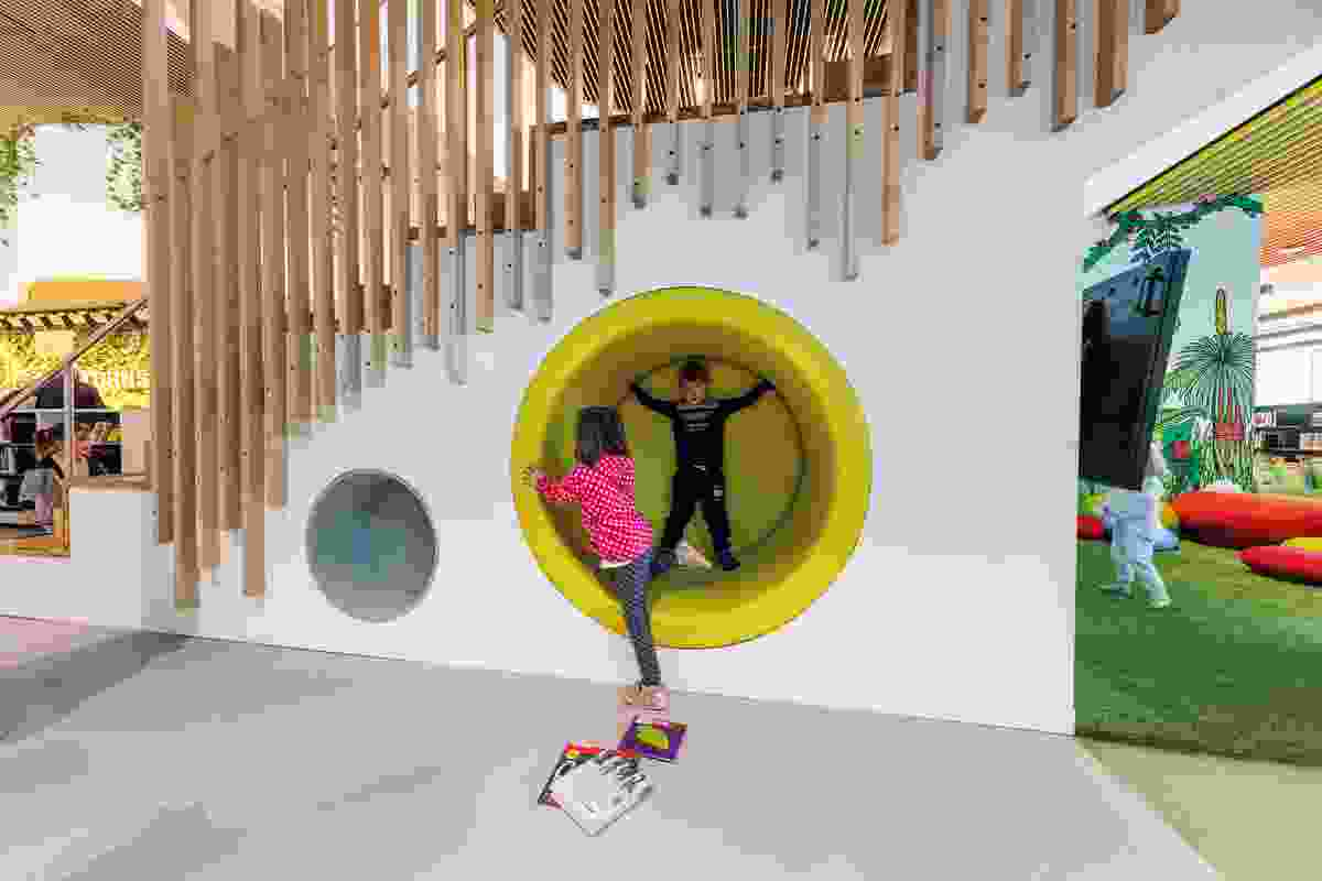 The children's area features stairs for climbing and cosy caves for curling up in.