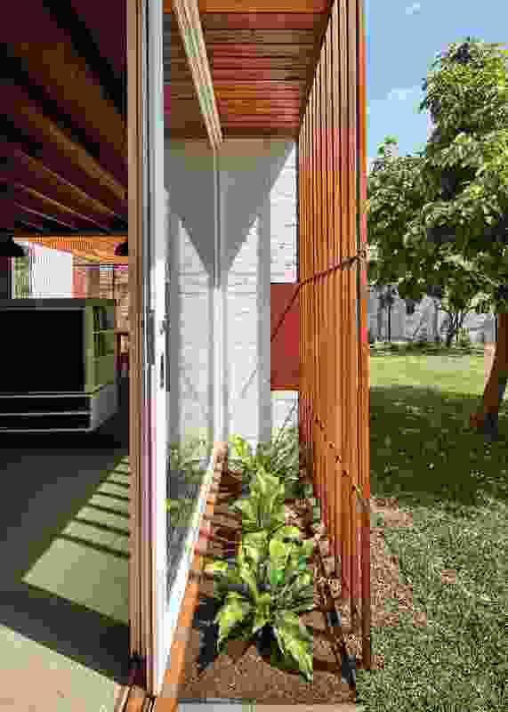 The interface between garden and interior is layered and takes many forms, including battened overhangs sheltering ground-level plantings.