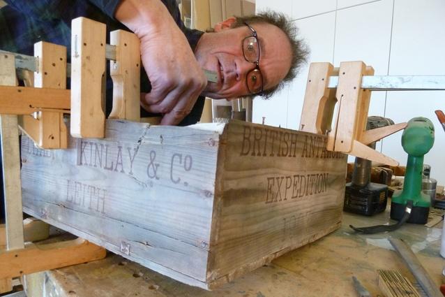 Mending a box at Shackleton's Hut.