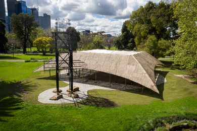 An Indian entrance tower used for ceremonies, called a tazia, provides a welcoming gesture to the MPavilion designed by Studio Mumbai.