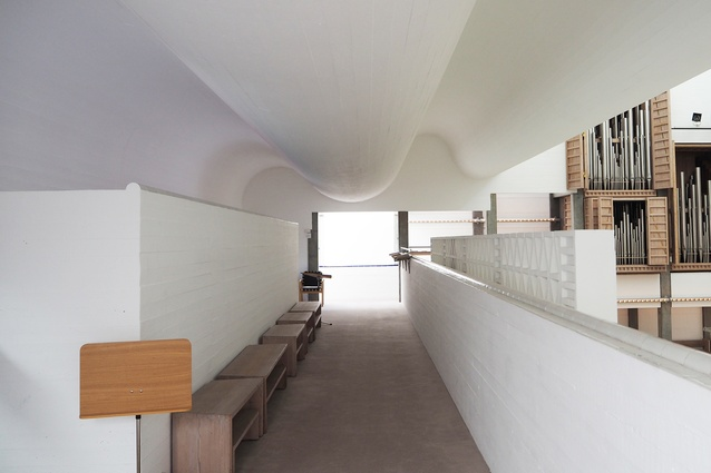 Upstairs, the waves of the concrete ceiling are experienced more closely.