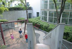 Children often play in the residential courtyard, adding to the embassy's relaxed feeling. The element seen on top of the white building is not a Denton Corker Marshall addition. Photographs Ben McMillan.