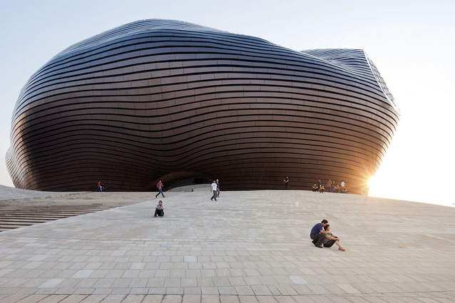 MAD Architects Ordos Museum, China: its irregular nucleus shape is a reaction against the rigid urban grid. It is cloaked in polished metal louvres to reflect and dissolve the surroundings.