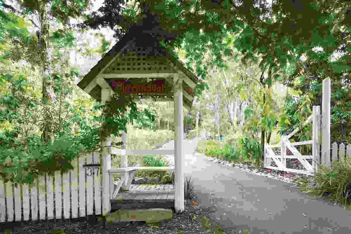 A romantic gatehouse and farm gate mark  the entrance.