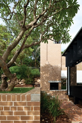 """The use of brick externally suggests a """"domesticated monumentality."""""""