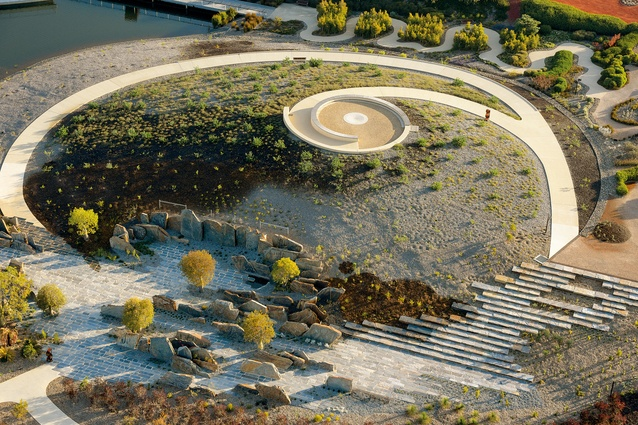 A curved pathway leads to the summit of an artificial hill, which offers spectacular views of the gardens.