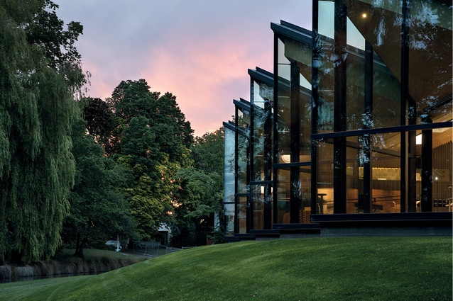 The folded glass wall on the southern side is light and ethereal, a window to St Andrew's College and the mature garden landscape.