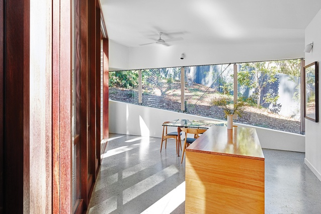 The kitchen/dining space was designed for flexibility of use and offers views to the landscape on both sides.