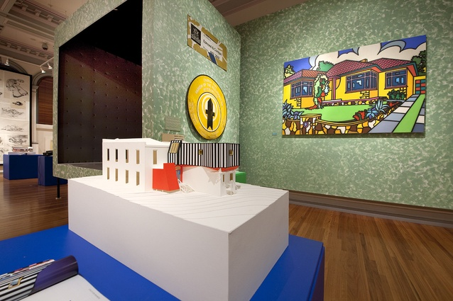 Howard Arkley's <em>Family Home</em> hangs beside the stage installation in the Gallery's main space.