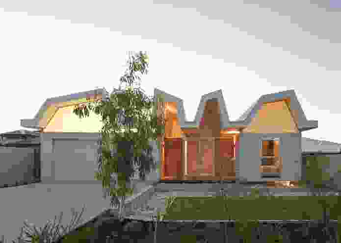 The main entry. External materials are robust and durable to protect the house from storms.