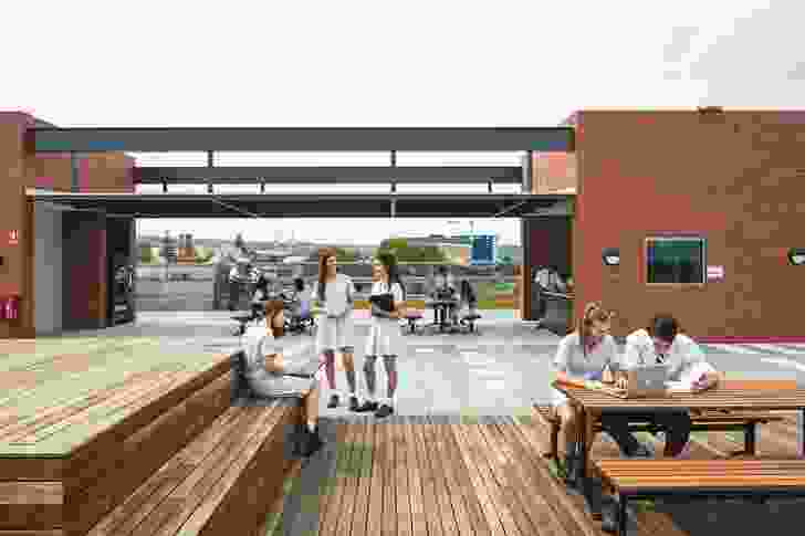 Timber decking on the outdoor area of the roof terrace provides an informal meeting space for students.