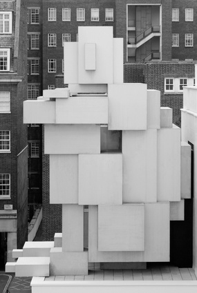Atop a plinth, A giant figure crouches down on The Beaumont Hotel's facade.