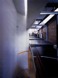Looking south down the stepped working platforms of the upper-level office space. Photograph Robert Frith.