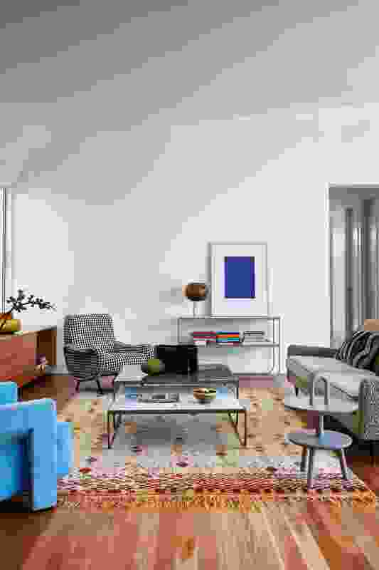 The subtle pitch of the living room ceiling curves down the back wall to temper what could have been a hard juncture. Artwork: Yves Klein. Styling: Alicia Sciberras.