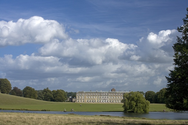 The west front of the late 17th century Petworth House, West Sussex, seen across Brown's lake and park.
