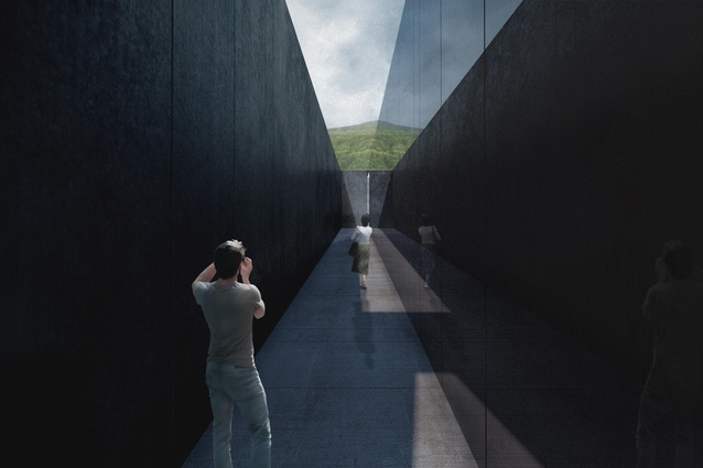 A dark corridor conveys the sombreness of the site's history.