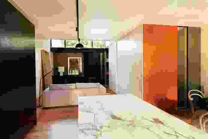 The interiors have a muted colour palette, with splashes of colour.