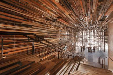 Designed by March Studio, Hotel Hotel's dramatic entry stair was constructed from more than 2150 pieces of recycled timber.
