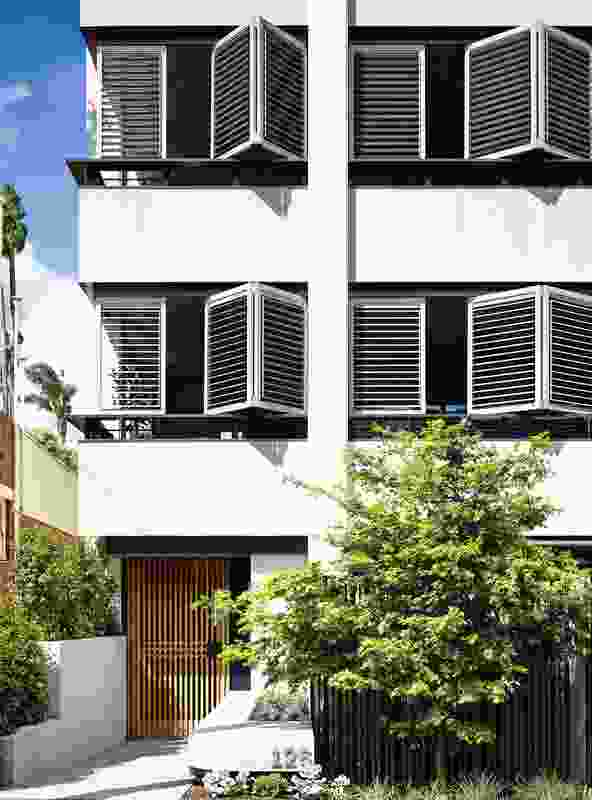 Operable shutters on the Walsh Street facade enable residents to control views and privacy.