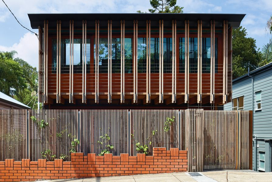 The home's expressed joists give insight into its tectonics and create a striking facade that facilitates engagement with the street.