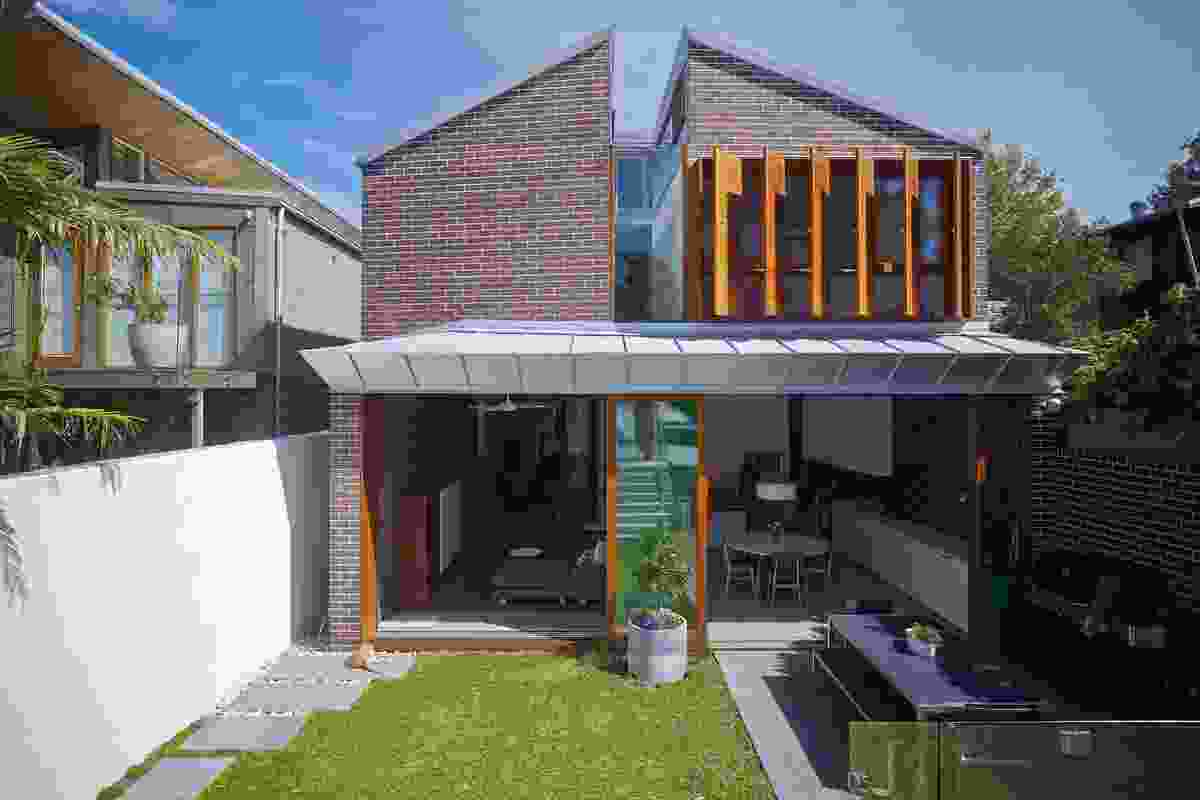 The brickwork is inspired by the street's traditional worker's cottages and is used inside and out.