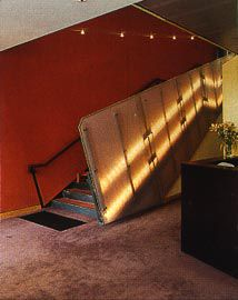 The main stair with the Simpson Desert red wall, which structures the fitout, beyond.