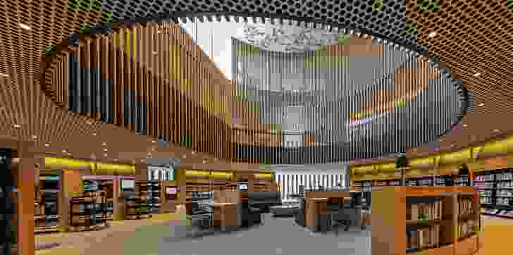 The library's five floor levels are connected by a three-storey void, which is clad in vertical timber fins.