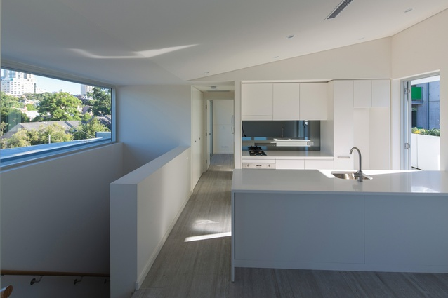 The apartments' thin nine-metre plan allows cross-penetration of light and the double height encourages stack ventilation.