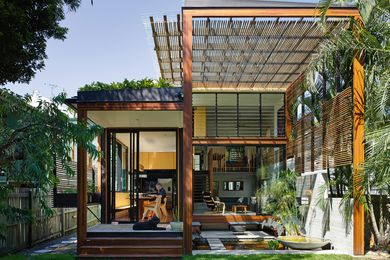 "A giant timber screen portal provides privacy from neighbours while creating ""a splendid moment of opening and embrace."""