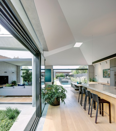 The subtle angles of the vaulted ceiling add nuance to the spatial experience of the living spaces.