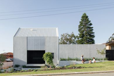 House A sits close to the site's front boundary, presenting a near-blank concrete facade to the street.